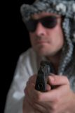 Angry terrorist. Focus over gun Stock Photo