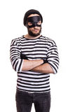 Angry thief with mask. Isolated on white background Royalty Free Stock Image