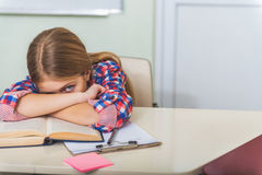 Angry tired female teenager in school Stock Photo