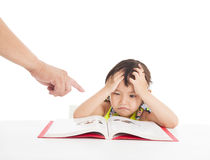 Angry and tired little girl studying Royalty Free Stock Images