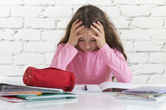 Angry and tired schoolgirl Stock Images