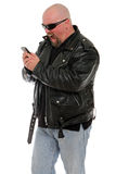 Angry tough guy. Tough guy making a very angry phone call Stock Photography