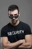 Angry tough male security guard with threatening look above sunglasses Royalty Free Stock Images