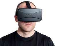 Angry and tough man using virtual reality headset isolated on wh stock photography