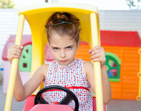 Angry toy car driver children girl. In playground Royalty Free Stock Photos