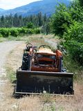 Angry tractor in the vineyards. Okanagan valley, BC, Canada Royalty Free Stock Image