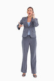 Angry tradeswoman yelling at caller Royalty Free Stock Image