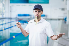 Angry trainer blowing whistle and holding stopwatch Stock Photos