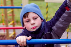 Angry or unhappy child in bad blue mood. A kid in bad mood, express anger and sadness stock images