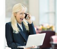 Angry unhappy woman screaming on phone Stock Photography