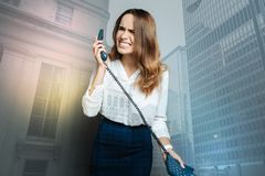 Angry unhappy woman shouting into the phone receiver Stock Image