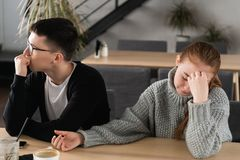 Angry unhappy young couple ignoring not looking at each other after family fight or quarrel, upset thoughtful spouses royalty free stock image