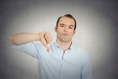 Angry, unhappy, young handsome man showing thumbs down Royalty Free Stock Photography