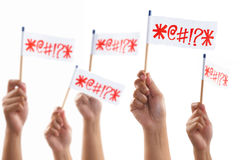 Angry uprising by hand holding lot of symbol flag. Hands uprising and holding angry flag, shot against white background Stock Photo