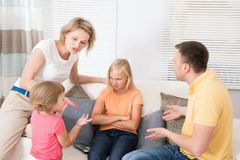 Angry upset family having argument. At Home Stock Image