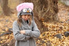 Angry and upset girl in the autumn forest stock images