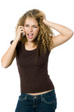 Angry and upset on the phone. A beautiful young women looking angry and upset on her phone Stock Photo