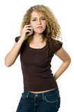 Angry and upset on the phone. A beautiful young women looking angry and upset on her phone Royalty Free Stock Photos