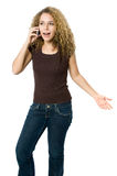 Angry and upset on the phone. A beautiful young women looking angry and upset on her phone Royalty Free Stock Image