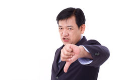 Angry, upset, serious businessman giving thumb down Stock Photo