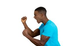 Angry upset young man, employee, fists in air, open mouth yelling Stock Photo