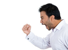 Angry upset young man putting up his fist in air as if to threaten someone Royalty Free Stock Photo