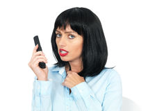 Angry Upset Young Woman Using a Mobile or Chordless Telephone Royalty Free Stock Photos