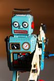 Tin toy robot carries computer circuit board, artificial intelligence concept Royalty Free Stock Images