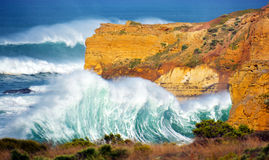 The Angry Waves. Off the limestone rock of the Southern Ocean, these waves beat furiously and powerfully on the shore of the limestone caves. This is shot along Stock Photography