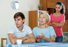 Angry wife and mother-in-law rebuking young man Royalty Free Stock Images