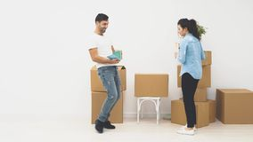 Angry wife is throwing a book into her husband. Then she is choking him and they coming away. The focus is blurring at. Concept quarrel in family. Copy space stock video footage