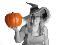 Angry witch. An angry Halloween witch with an orange pumpkin Stock Photography
