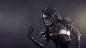 Angry witch in black latex clothes Royalty Free Stock Image