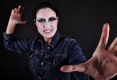 Angry woman. Mad girl with clown make-up Royalty Free Stock Photos