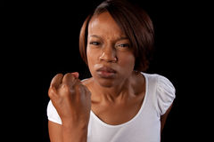 Angry woman. An angry woman shakes her fist at the camera stock image