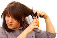 Angry woman. Attractive woman cut her hair Royalty Free Stock Photo