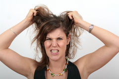 Angry Woman. A young angry woman is pulling her hair Royalty Free Stock Photo