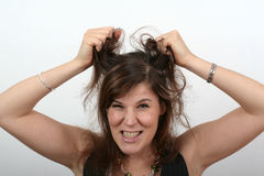 Angry Woman. A young angry woman is pulling her hair Royalty Free Stock Images