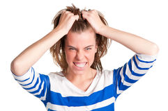 Angry Woman. Frustrated and angry woman with hands in her hair pulling Stock Photos