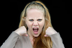 Angry woman. Woman who looks very angry with clenched fists in front of her Stock Photo