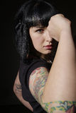 Angry woman. The elbow of a young woman with tattoos Royalty Free Stock Photo