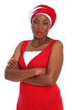 Angry woman. Angry,african woman wearing a red dress and fitting headscarf. Isolated on a white background royalty free stock photos