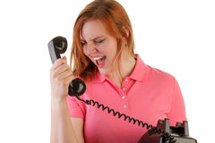 Angry woman on antique phone Royalty Free Stock Photos