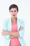 Angry woman with arms crossed looking at camera Royalty Free Stock Image