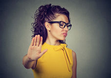 Angry woman with bad attitude giving talk to hand gesture Royalty Free Stock Photo