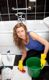 Angry woman in a bathroom Stock Photo