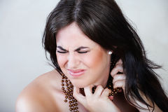 Angry woman with beads Royalty Free Stock Images