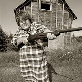 Angry woman with big gun Stock Image