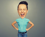 Angry woman with big head. Over grey background royalty free stock photography