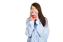 Angry woman in big shirt holding alarm clock. Royalty Free Stock Images